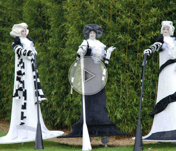 music tones, black and white, black and white stilts walkers, trio stilts walkers, music, trio stilts