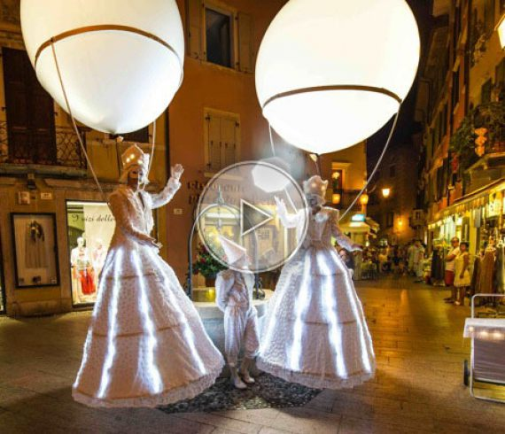 Lighting balloons on stilts, lighting stilts, italian stilts, white stilt walkers, lighting balloon