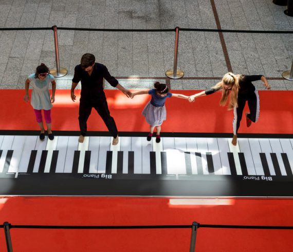 giant piano performers, big piano performers, pianists, piano, mall piano, dancing piano, dancers on piano