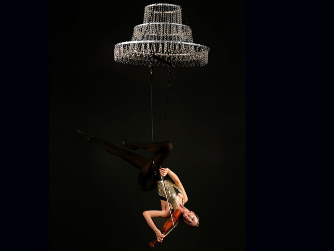 Violins, violin show, violinist, violin strings, balancing, balance, music show, aerial, contortion, contortionist, arial violin, acrobat, acrobatic show, musical show