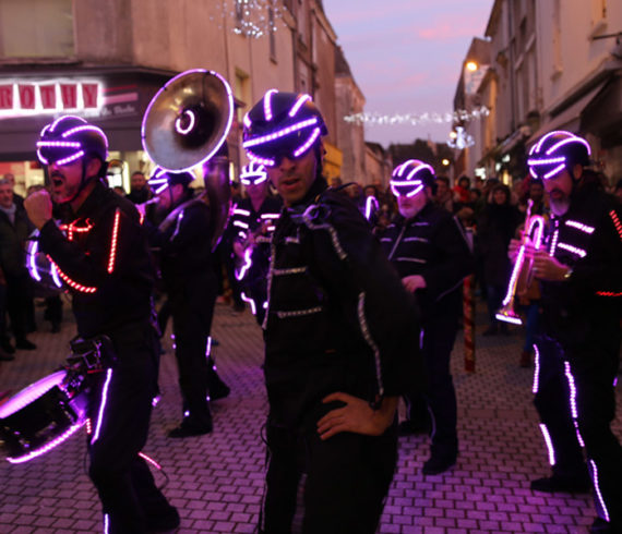 Led marching band, led brass band, led roaming band, led roaming entertainment, led walk about act, led walk around entertainment, led show, led roaming show, led musical show, led music show, led music act, led music performance, lighting brass band, roaming brass band, original brass band, unusual brass band