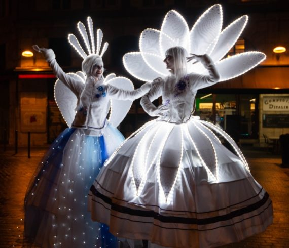 Lighted stilts, led stilts, stilts walkers, led entertainment, lighted act, Christmas act, Christmas event, winter show, flower themed, flowers stilts, white party, white themed event, white stilts