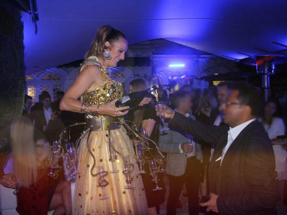 champagne waitress, champagne, champagne goddess, champagne on stilts, waitress on stilts, champagne show, champagne entertainment, monaco entertainment, champagne performer, champagne artist