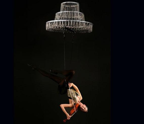 Violins, violin show, violinist, violin strings, balancing, balance, music show, aerial, contortion, contortionist, arial violin, acrobat, acrobatic show, musical show